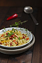 Vegetable stir-fry with millet on plate - MYF000533
