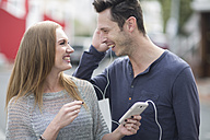 Young couple listening music with earphones - ZEF000009