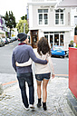 Young couple walking arm in arm on the street - ZEF000082