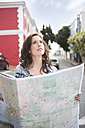 Young woman orientating with city map - ZEF000142