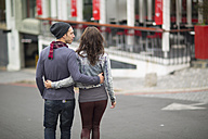 Young couple walking arm in arm on the street - ZEF000054