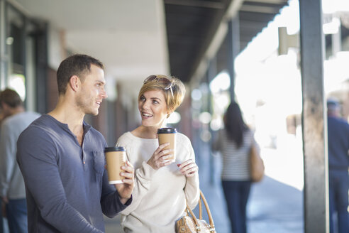 Smiling couple with coffees to go - ZEF000119