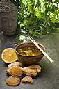 Ginger lemon tea in a tea bowl with fresh lemongrass, candied and fresh ginger - CSTF000390