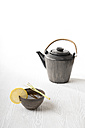 Green Sencha tea in a tea bowl with lemongrass, a teapot - CSTF000396