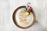 Chai Latte Iced tea in a tea bowl with cinnamon stick and vanilla pod - CSTF000398