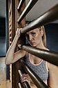 Serious woman at wallbars in gym - MFF001161