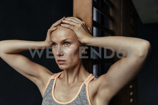 Serious woman at wallbars in gym - MFF001163