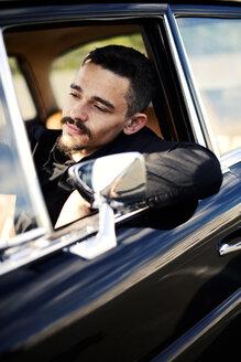 Young man inside vintage car - VRF000112