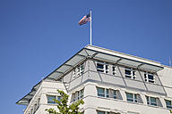 Germany, Berlin, Part of facade of US embassy with American flag - WIF000952