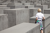 Germany, Berlin, Holocaust Memorial, Mature woman between steles - WIF000947