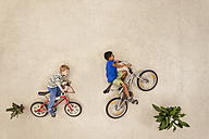 Children riding bicycle in park - BAEF000766