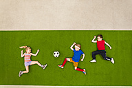 Children playing soccer in park - BAEF000799