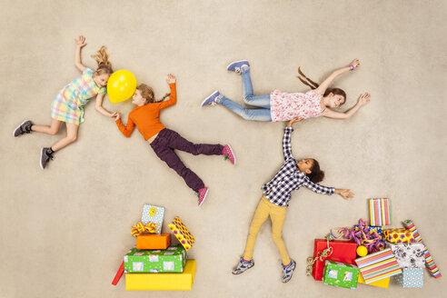 Children with heaps of birthday presents - BAEF000975