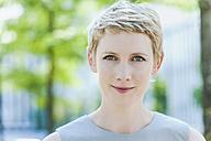 Portrait of smiling blond woman - TCF004309