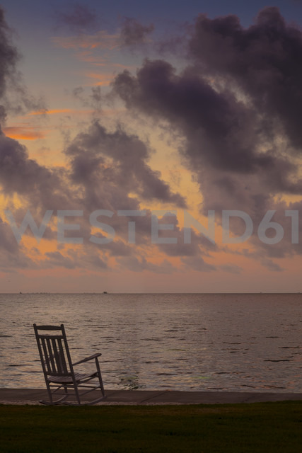 USA, Texias, Rocking chair at beach, Early morning at the Gulf Coast - ABAF001456