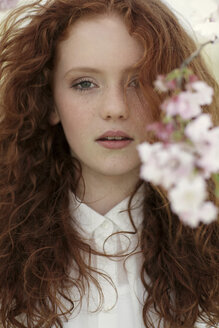 Portrait of daydreaming girl with curly red hair - GDF000410