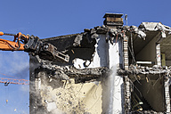Germany, demolition equipment knocking down an old multi-family house - MIDF000001