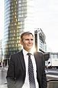 Germany, Berlin, Businessman in city, portrait - FKF000611