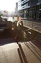 Germany, Berlin, Businessman running on stairs - FKF000617