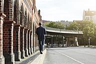 Germany, Berlin, Businessman walking in the city - FKF000635