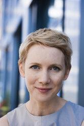 Portrait of smiling blond woman - TCF004445
