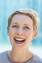 Portrait of laughing blond woman - TCF004448