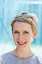 Portrait of smiling blond woman - TCF004449