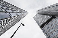 Germany, Hesse, Frankfurt, view to facades of modern office buildings Skyper and Silver Tower from below - WDF002575