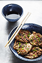 Japanese buckwheat pancakes with tofu and vegetable, chopsticks and bowl of soy sauce - EVGF000823