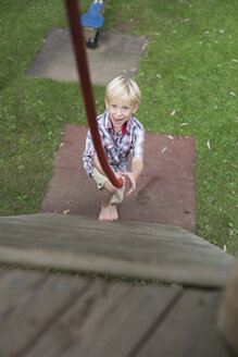 Portrait of little boy having fun on a playground - DAWF000133