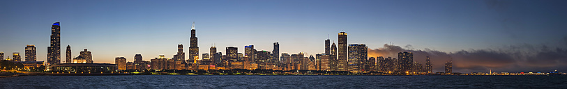 USA, Illinois, Chicago, skyline with Lake Michigan at dusk - FO006873