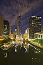 USA, Illinois, Chicago, High-rise buildings, Trump Tower at Chicago River at night - FO006985
