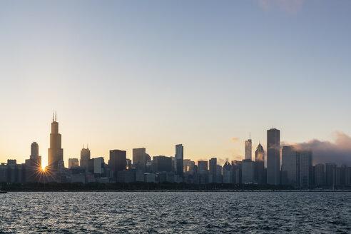 USA, Illinois, Chicago, Skyline, Willis Tower and Lake Michigan at sunset - FO007227