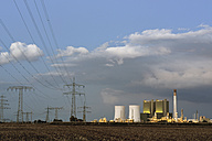 Germany, Saxony-Anhalt, Schkopau, power pylons and coal-fired power plant - LYF000280