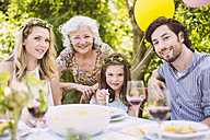 Portrait of happy family of three generations on a garden party - MFF001259