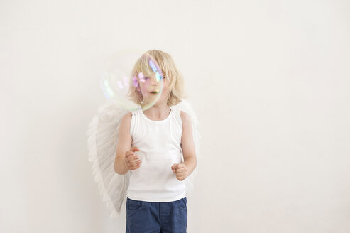 Portrait of little boy watching a soap bubble - MJF001339
