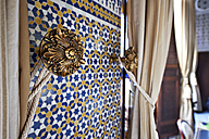 Morocco, Fes, Hotel Riad Fes, tied curtain and wall mosaic - KMF001487