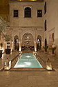 Morocco, Fes, Hotel Riad Fes, courtyard with lightened pool by night - KMF001429