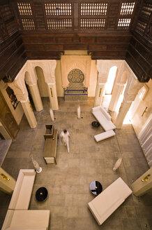 Morocco, Fes, Hotel Riad Fes, person walking through lounge - KMF001441