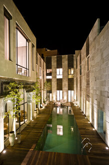 Morocco, Fes, Hotel Riad Fes, courtyard with swimming pool by night - KMF001450