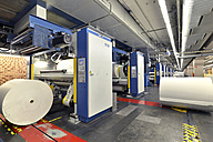 Germany, Presses with rolls of paper in a printing shop - SCH000391