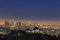 USA, California, Los Angeles, Skyline and Griffith Observatory in the evening - FOF006994