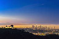 USA, California, Los Angeles, Skyline and Griffith Observatory before sunrise - FO006996