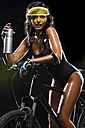 Woman with mountain bike and water bottle in front of black background - MAEF009055