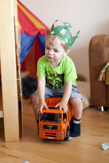 Portrait of little boy sitting on toy car - AF000087