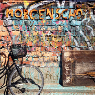 Bicycle front of a wall with text - AF000117