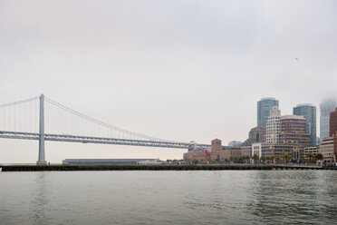 USA, California, San Francisco, Oakland Bay Bridge and Southern part of the skyline in the morning - BRF000723
