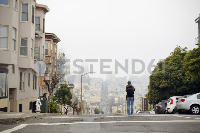 USA, California, San Francisco, woman on street taking a picture - BRF000738
