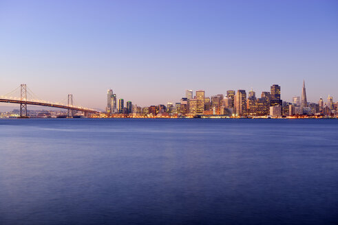 USA, California, San Francisco, Oakland Bay Bridge and skyline of Financial District at sunrise - BR000782