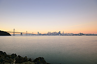 USA, California, San Francisco, Oakland Bay Bridge and skyline of Financial District in morning light - BRF000778